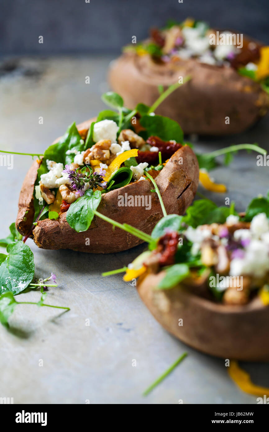 Baked sweet potato with salad - Stock Image