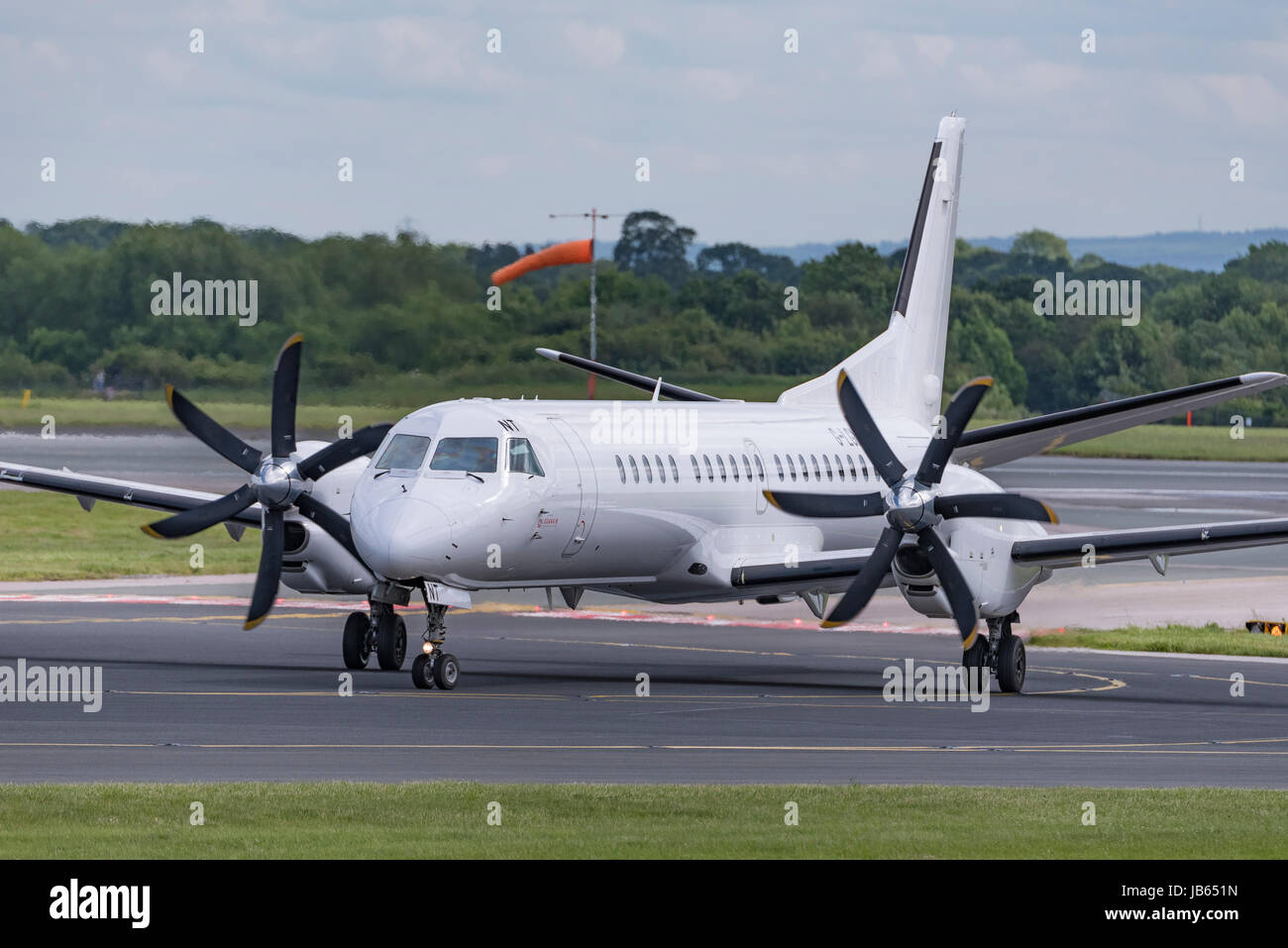Aircraft Manchester airport Loganair turboprop - Stock Image