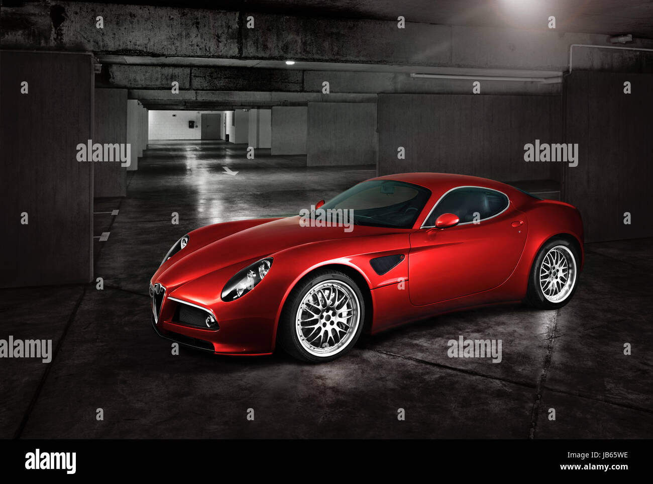 Italian sports red car in the underground parking - Stock Image