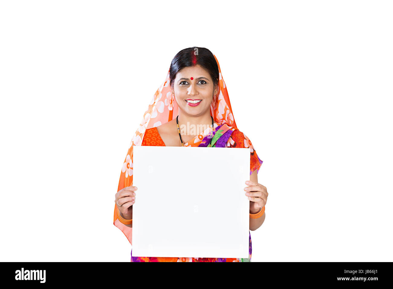 Smiling 1 Indian Rural Woman Showing White Board In Studio shot on White Background - Stock Image