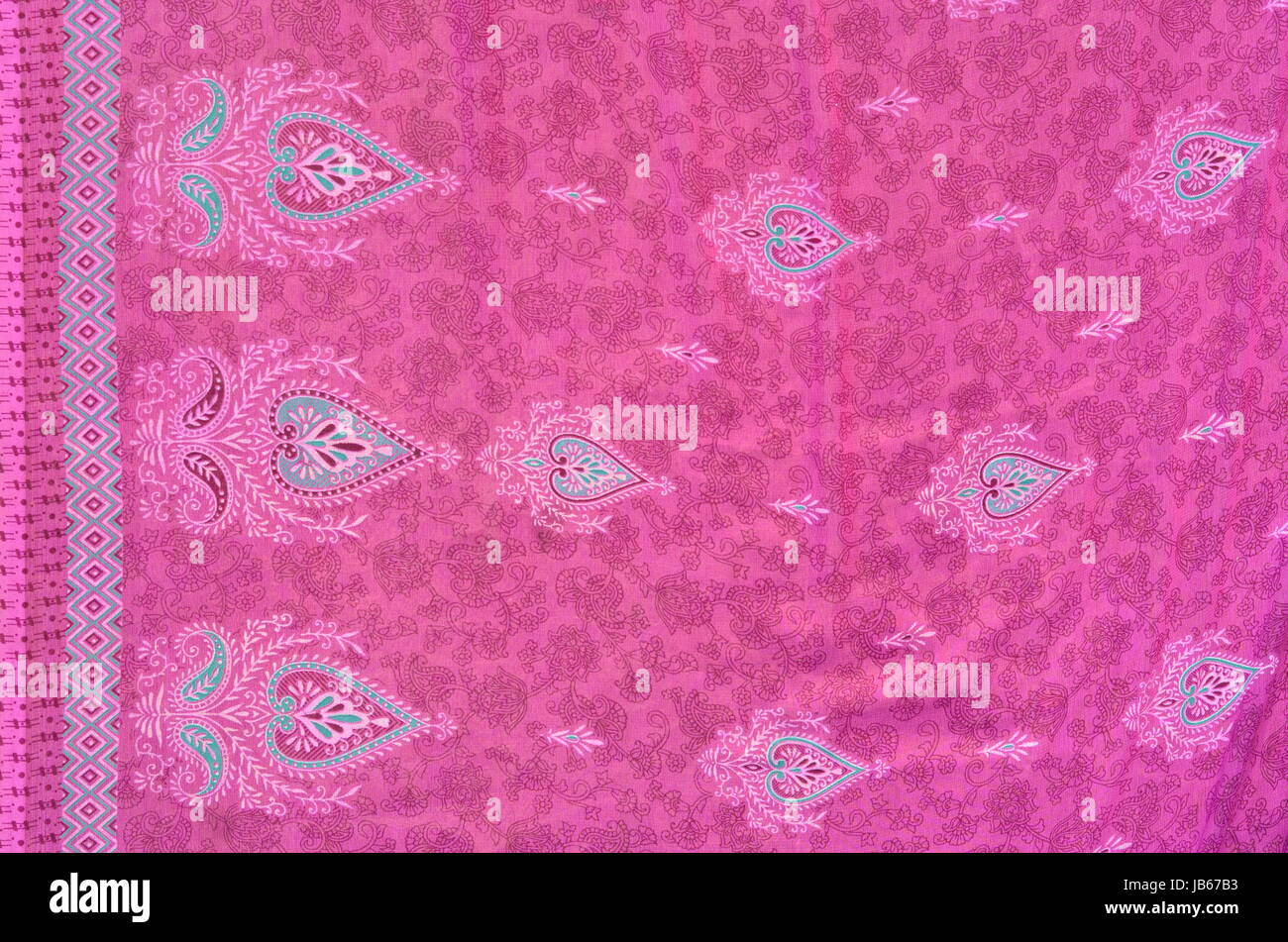 Pink Fabric Texture of a Sarong with stylised hearts - Stock Image