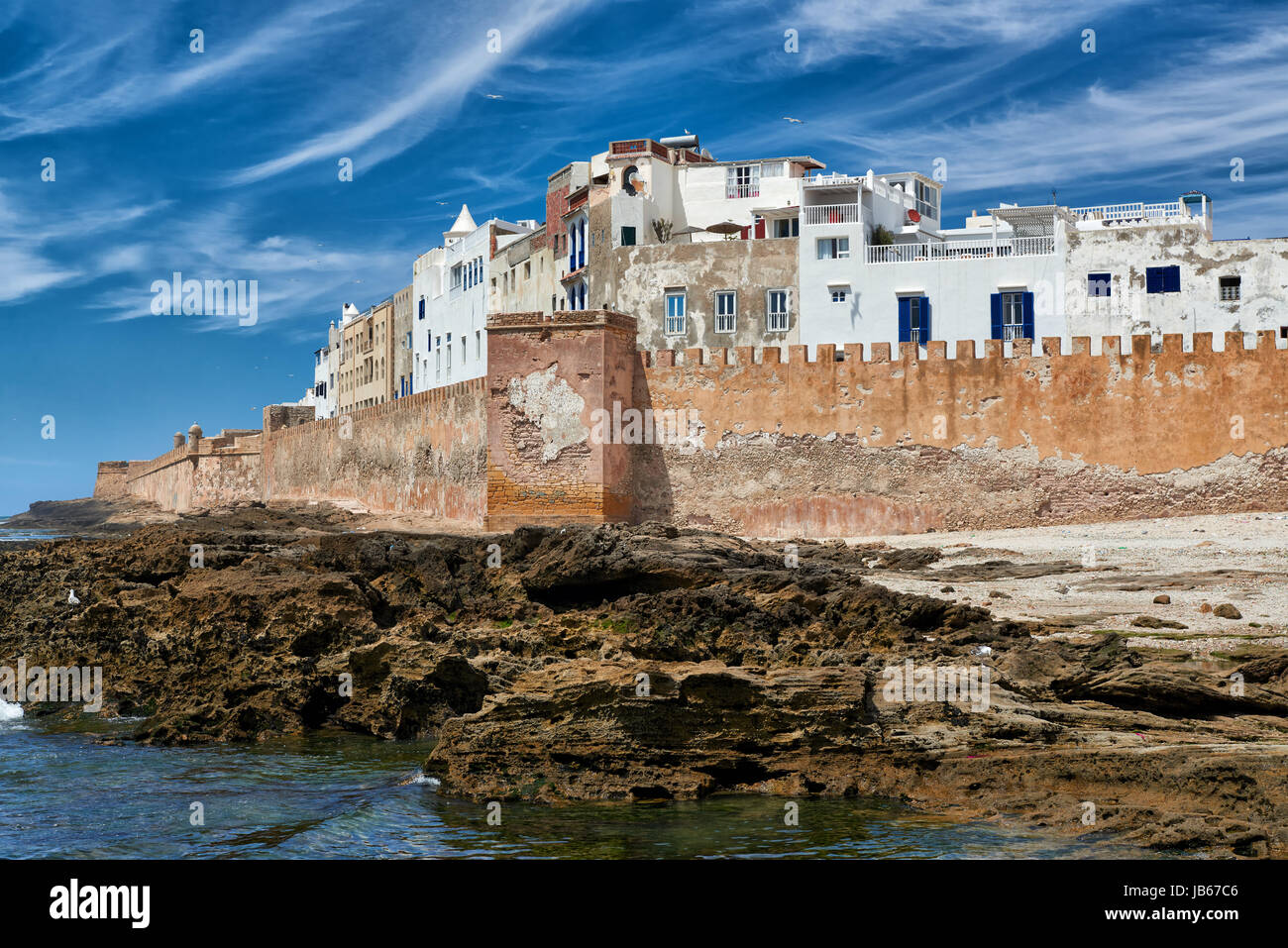 rampart and historical medina of Essaouira seen from ocean site, UNESCO world heritage site, Morocco, Africa - Stock Image