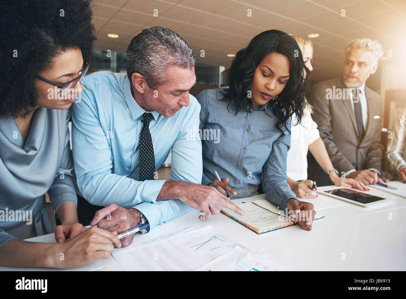 group contemporary office white espresso black and white group of people doing teamwork in contemporary office stock