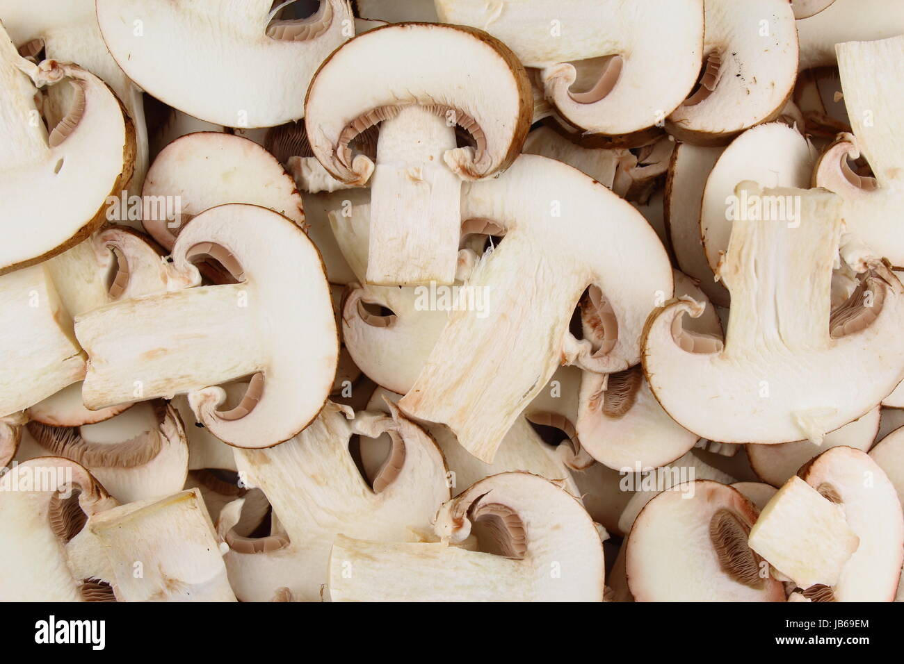 fresh mushroom slices as a food background texture - Stock Image