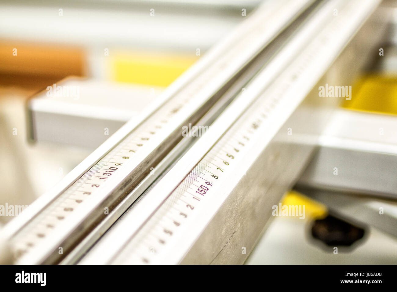 Detail of a scale ruler of a circular saw in a joinery. Palhoca, Santa Catarina, Brazil. - Stock Image