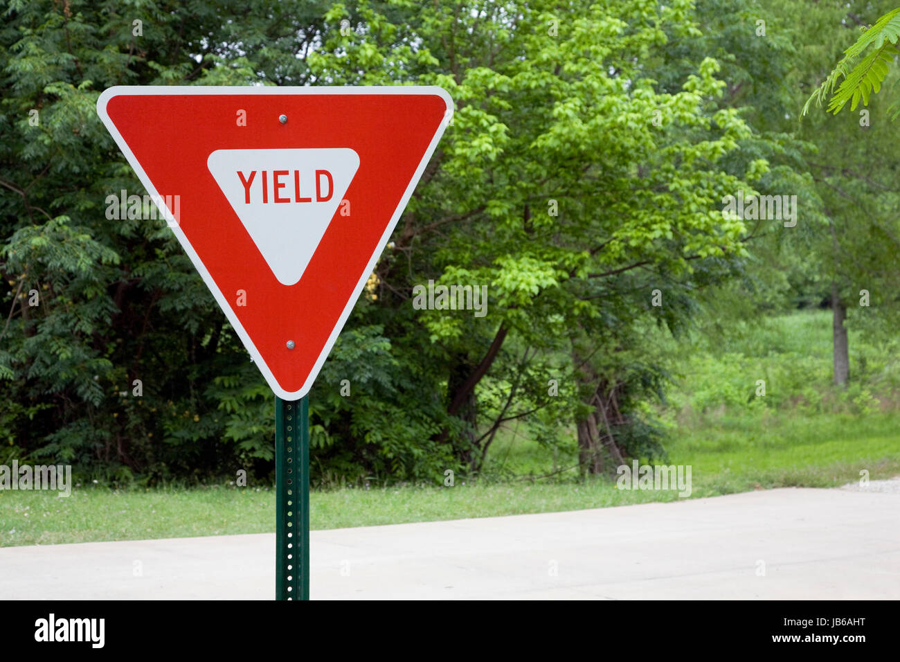 Yield Sign In A Park - Stock Image