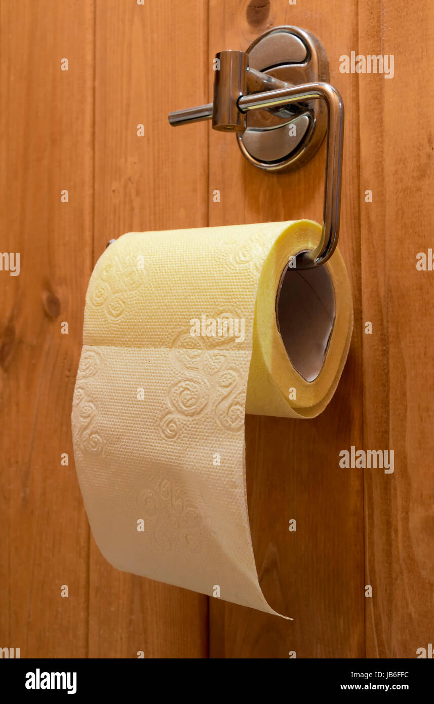 Roll of yellow toilet paper closeup Stock Photo: 144588064 - Alamy