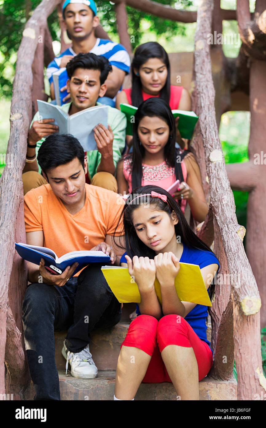 Group Indian College Girls And Boys Friends Read Book Study Exam Preparing