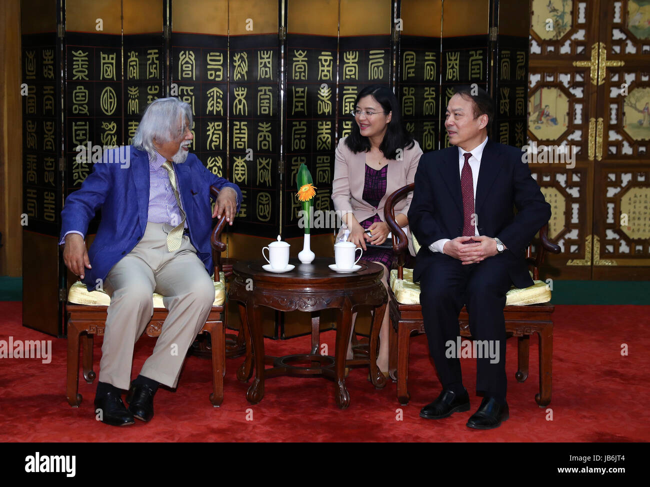Beijing, China. 9th June, 2017. He Ping (R, front), editor-in-chief of China's Xinhua News Agency, meets with - Stock Image