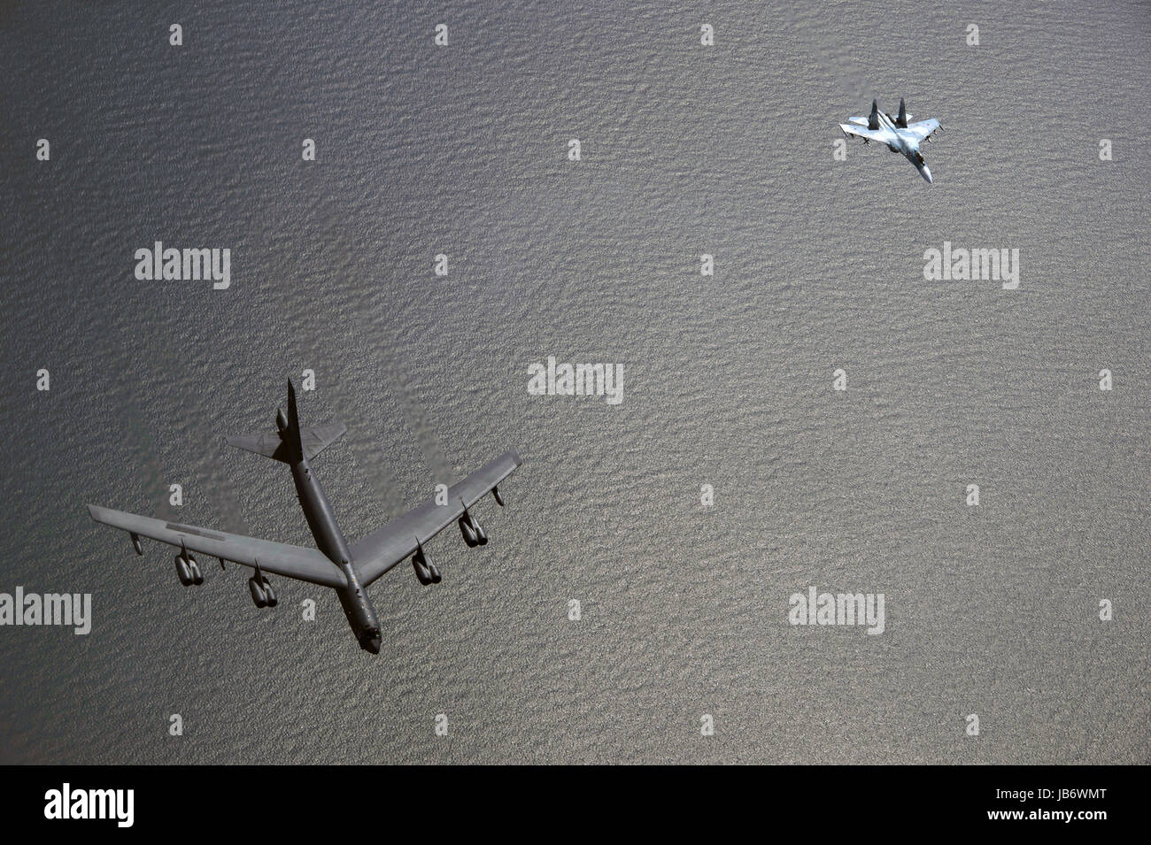 Baltic Sea. 09th June, 2017. A U.S. Air Force B-52H bomber, left, from the 2nd Bomb Wing is intercepted by a Russian - Stock Image