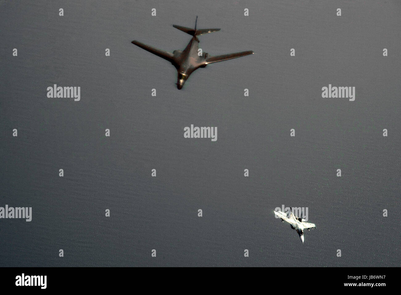 Baltic Sea. 09th June, 2017. A U.S. Air Force B-1B Lancer bomber, left, from the 28th Bomb Wing is intercepted by - Stock Image