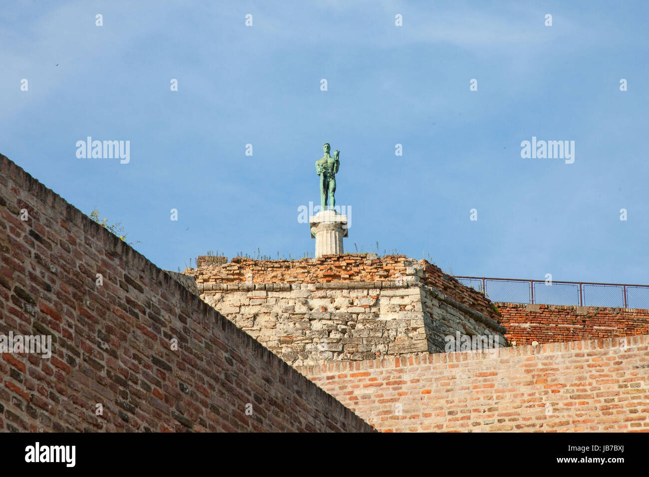 Victor statue on Kalemegdan fortress seen from the bottom in Belgrade, Serbia   Picture of the iconic victory statue - Stock Image