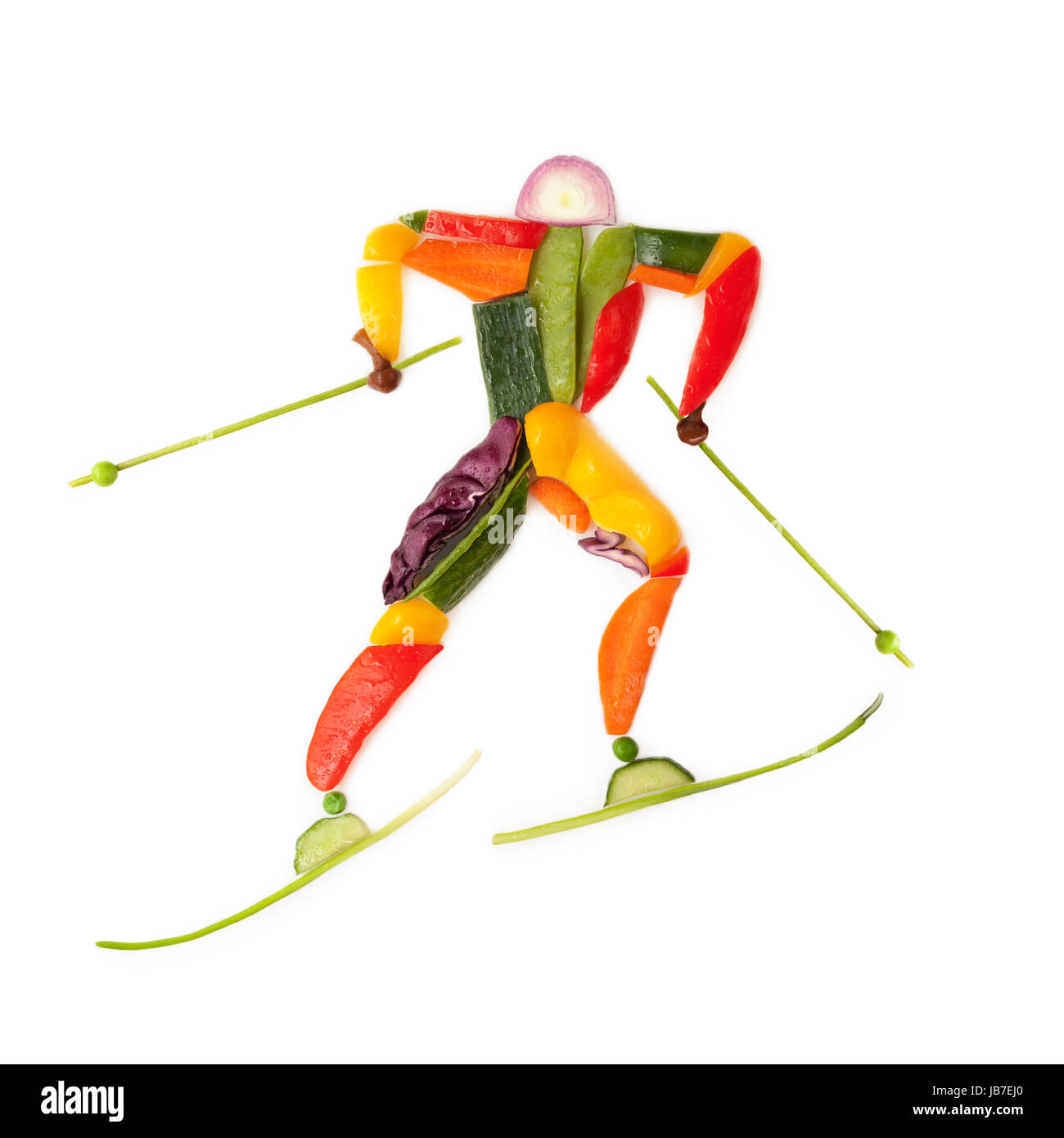 Fruits and vegetables in the shape of a winter skier. - Stock Image