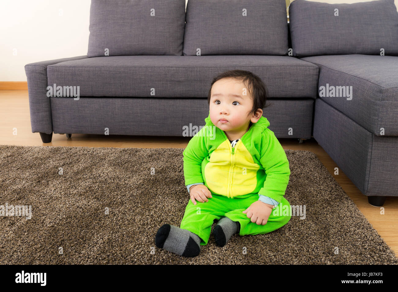 asian baby with dinosaur halloween party costume stock photo