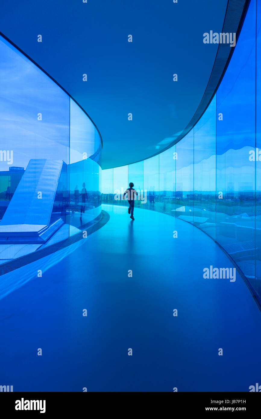 "Boy running through Olafur Eliassons installation ""Your rainbow panorama"" on top of Aarhus Art Museum - Stock Image"