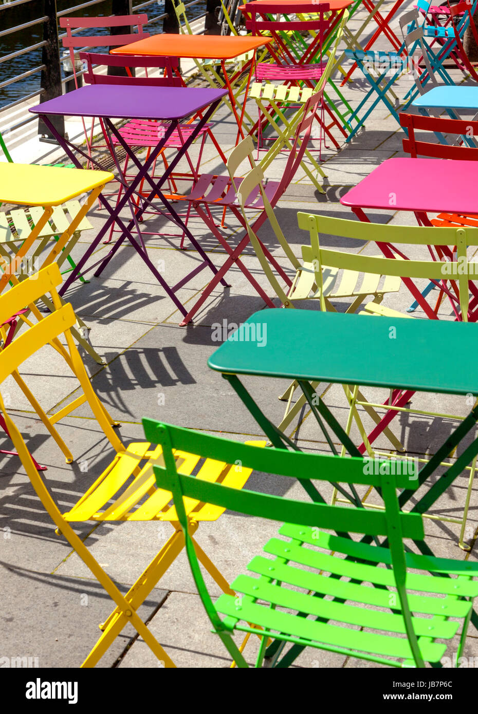 Vibrant colorful chairs and tables at outdoor area of cafe at Aarhus, Denmark - Stock Image