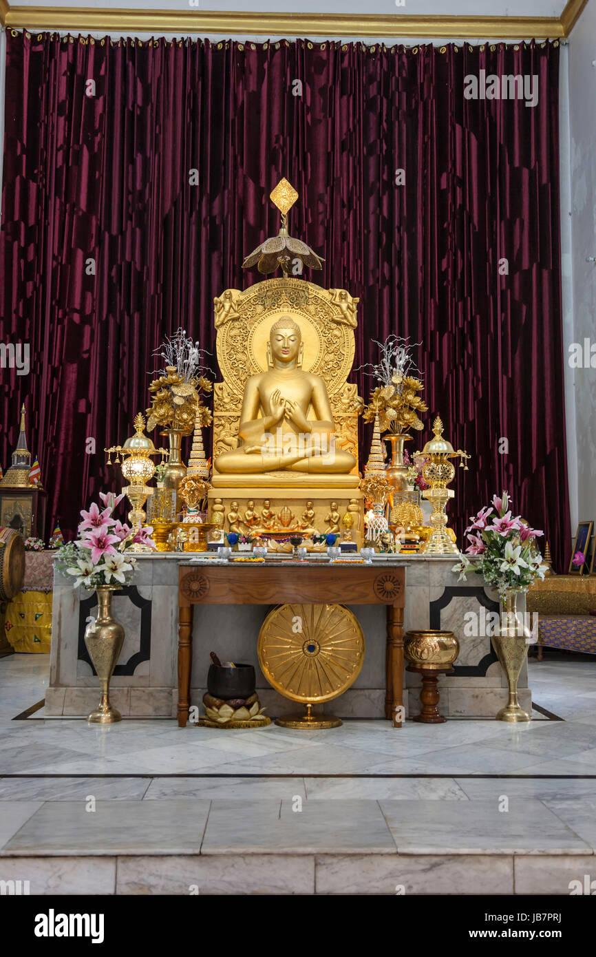 Statue of Buddha inside the Mulagandha Kuti Vihar, a Buddhist temple near Sarnath,India,Asia - Stock Image