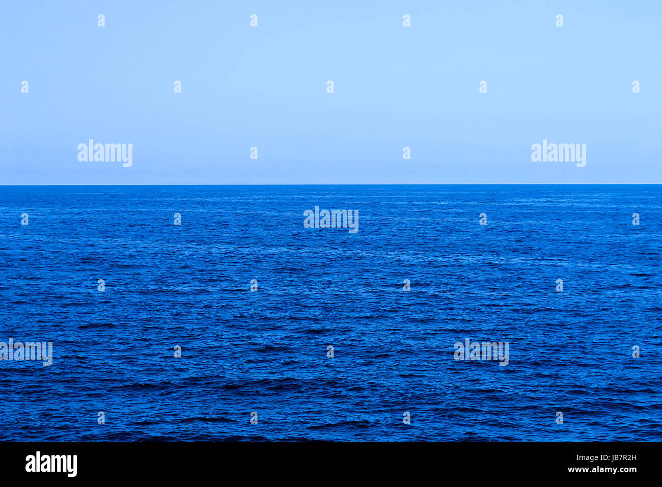 Ocean horizon in clear sky Stock Photo
