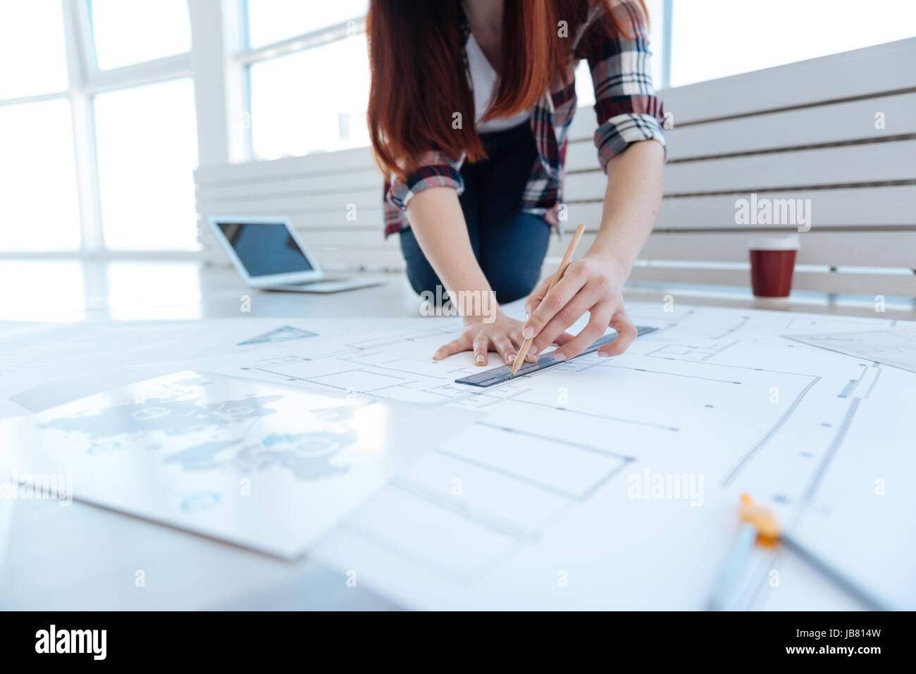 Engineering draft being drawn by a woman - Stock Image