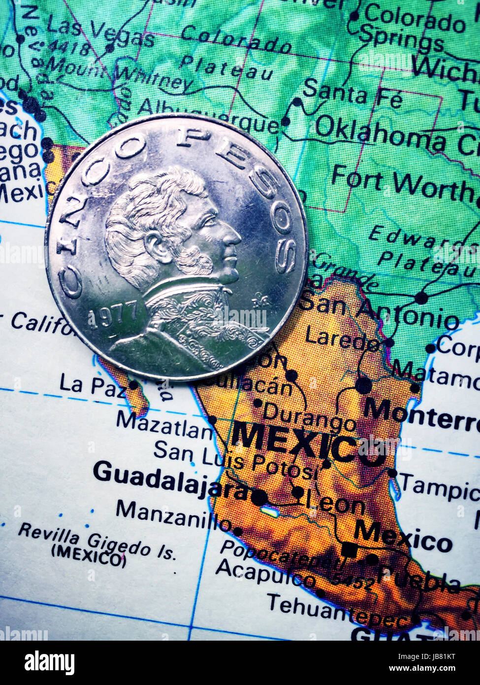 Mexican Coin on World Map Still Life - Stock Image