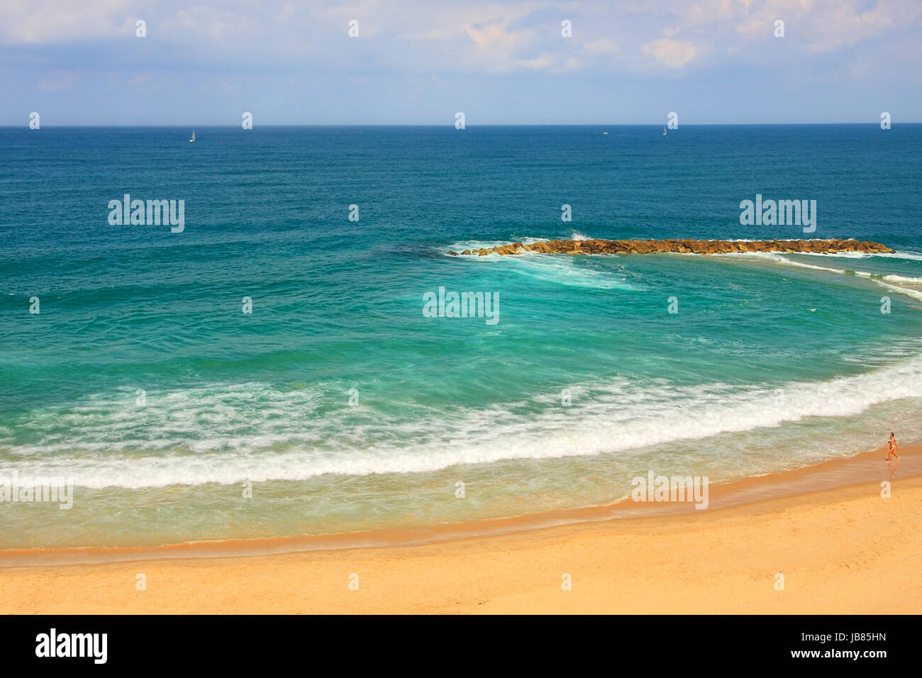 View from above on sandy beach along beautiful Mediterranean sea at hot day in Israel. - Stock Image