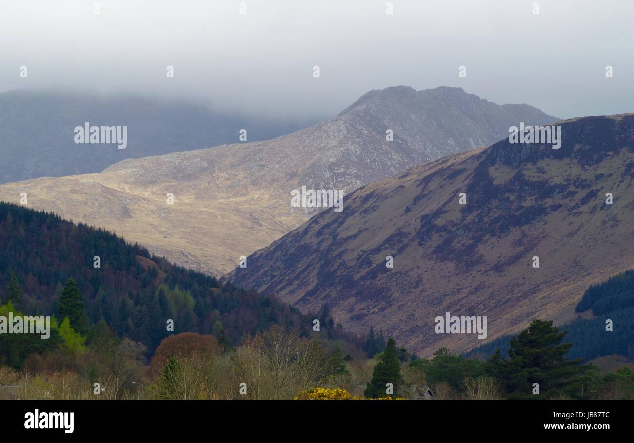 Cloudy Mountains in Moody Dramatic Scottish Landscape. Isle of Arran, Scotland. April, 2017. - Stock Image
