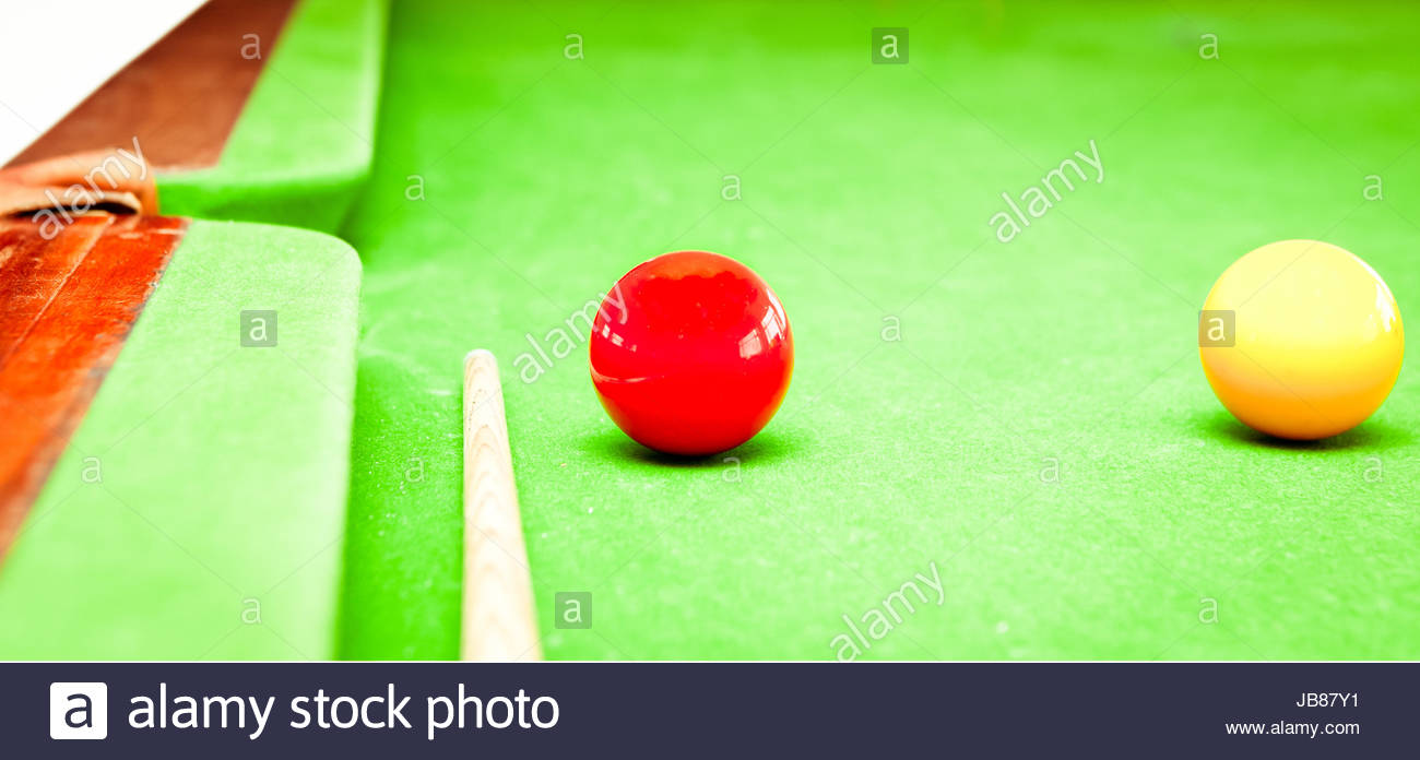Close up of two balls and a cue on a traditional billard table - Stock Image