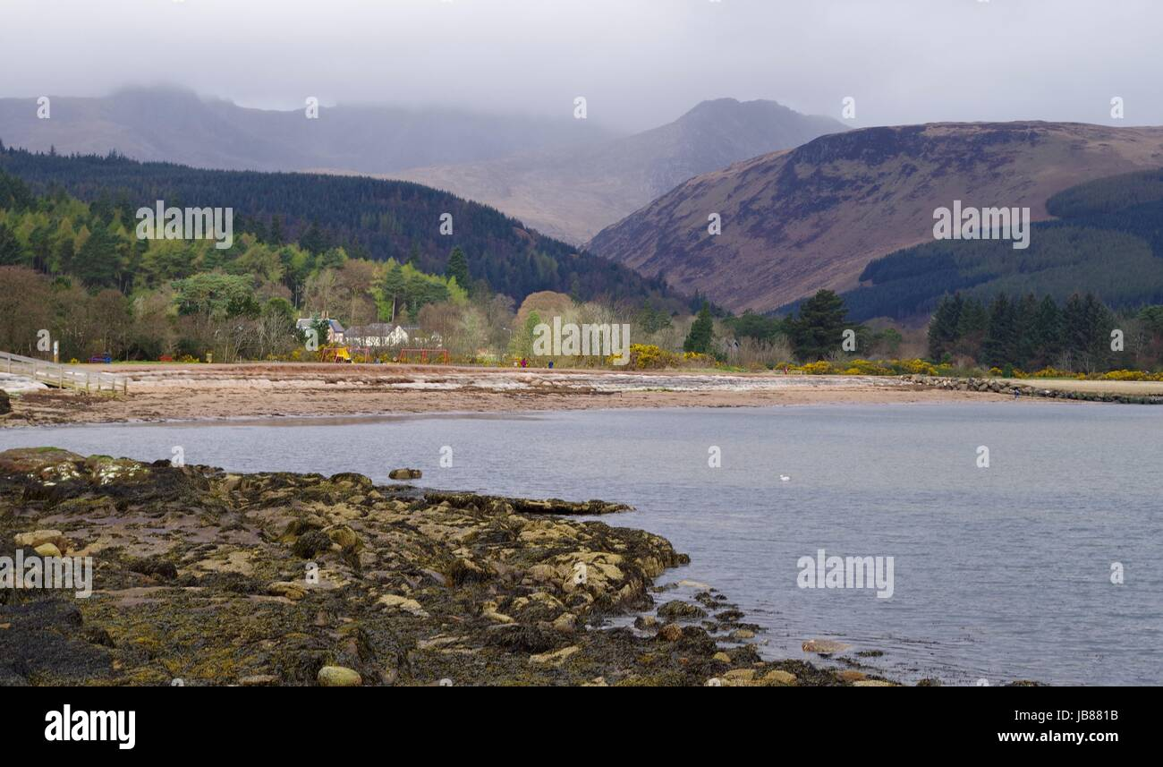 Misty Mountains, Forest and Coastline. Brodrick Bay, Isle of Arran, Scotland. April, 2017. - Stock Image