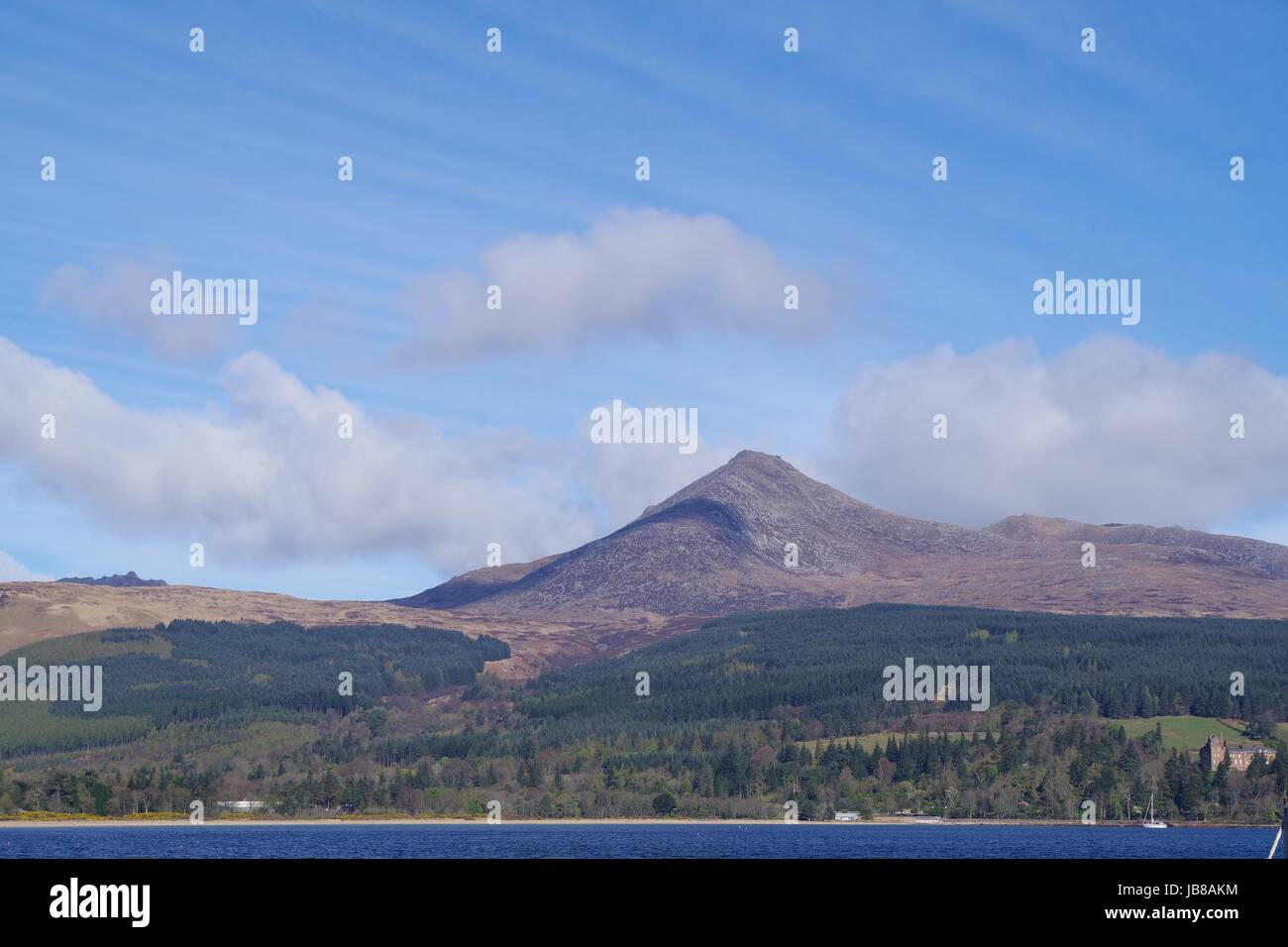 Goat Fell Mountain and Brodrick Castle, Isle of Arran, West Coast of Scotland, April 2017. - Stock Image