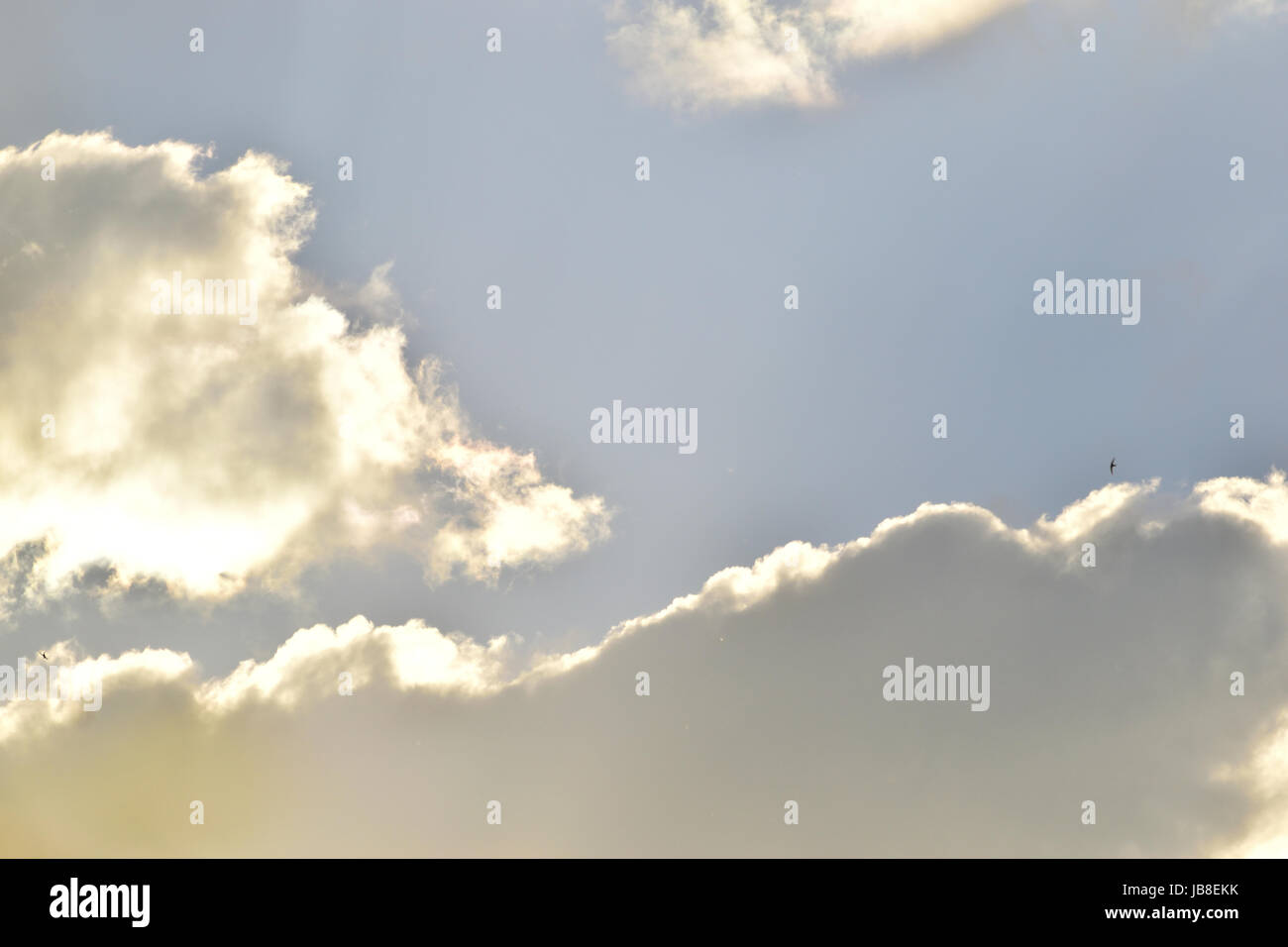 Sunshine through the clouds - Stock Image