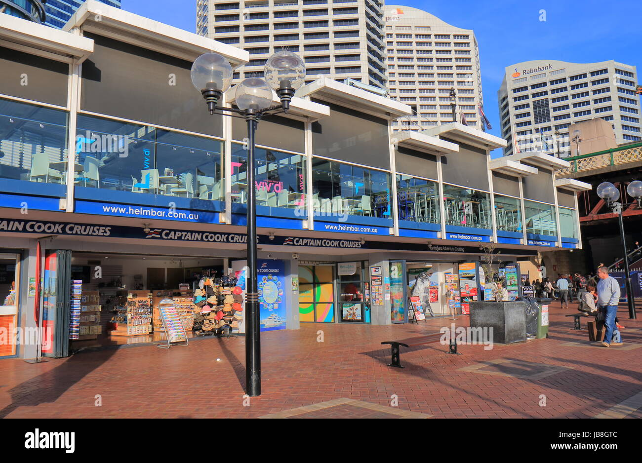 People visit Darling Harbour cruise ticket office in Sydney Australia. - Stock Image