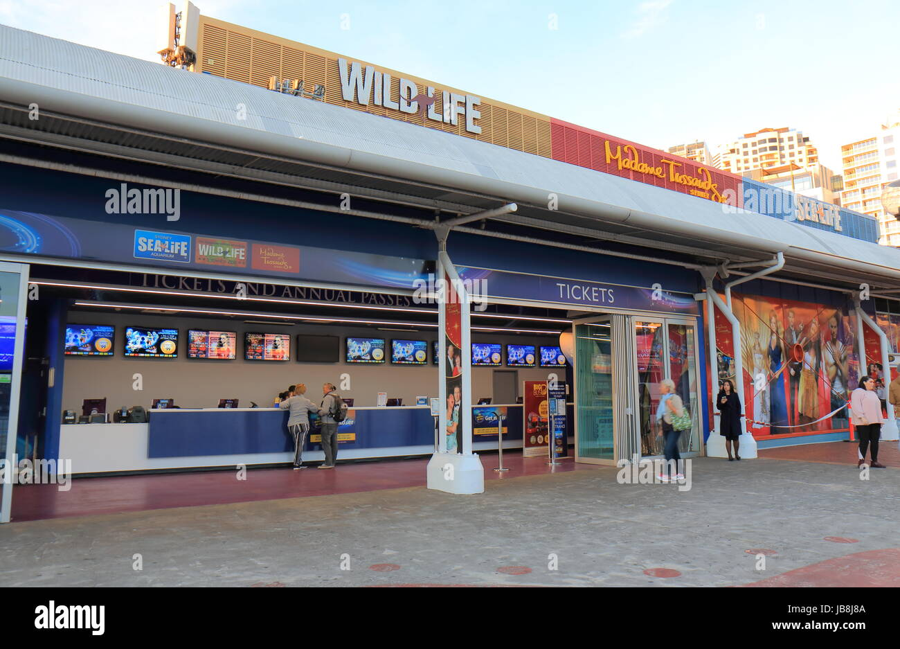 People visit ticket office for Sealife in Sydney Australia. Wildlife and Madame Tussauds. - Stock Image