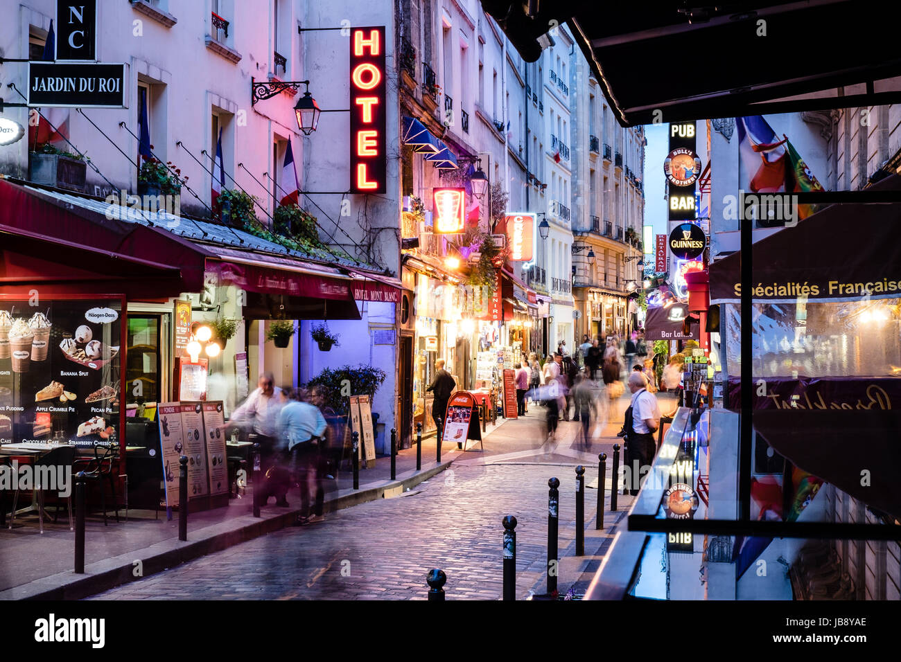 Bars and cafes at night in St Germain-des-Pres, Left Bank, Paris, France - Stock Image