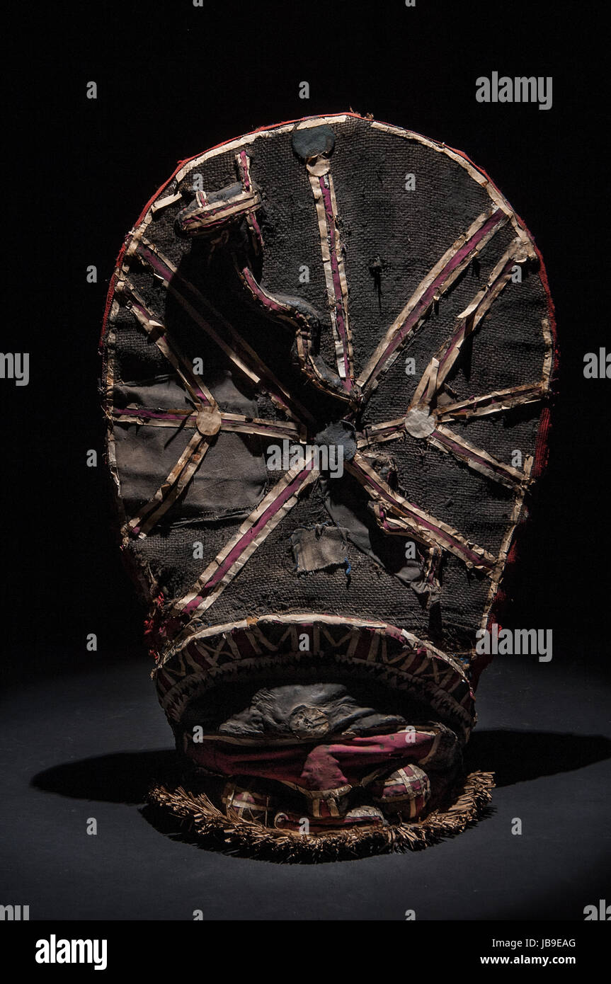 African wooden mask isolated on black background Stock Photo