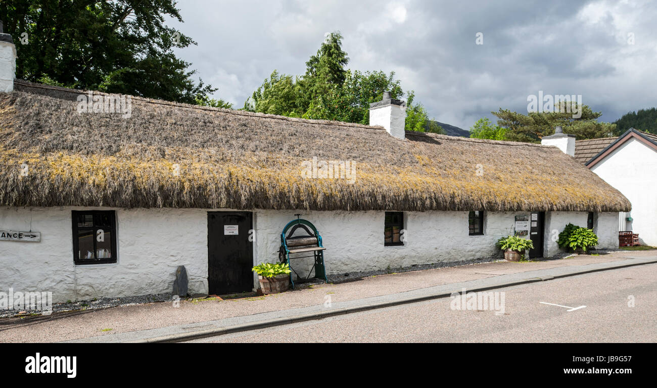 Glencoe & North Lorn Folk Museum in restored longhouse with thatched roof, Lochaber, Scottish Highlands, Scotland, - Stock Image
