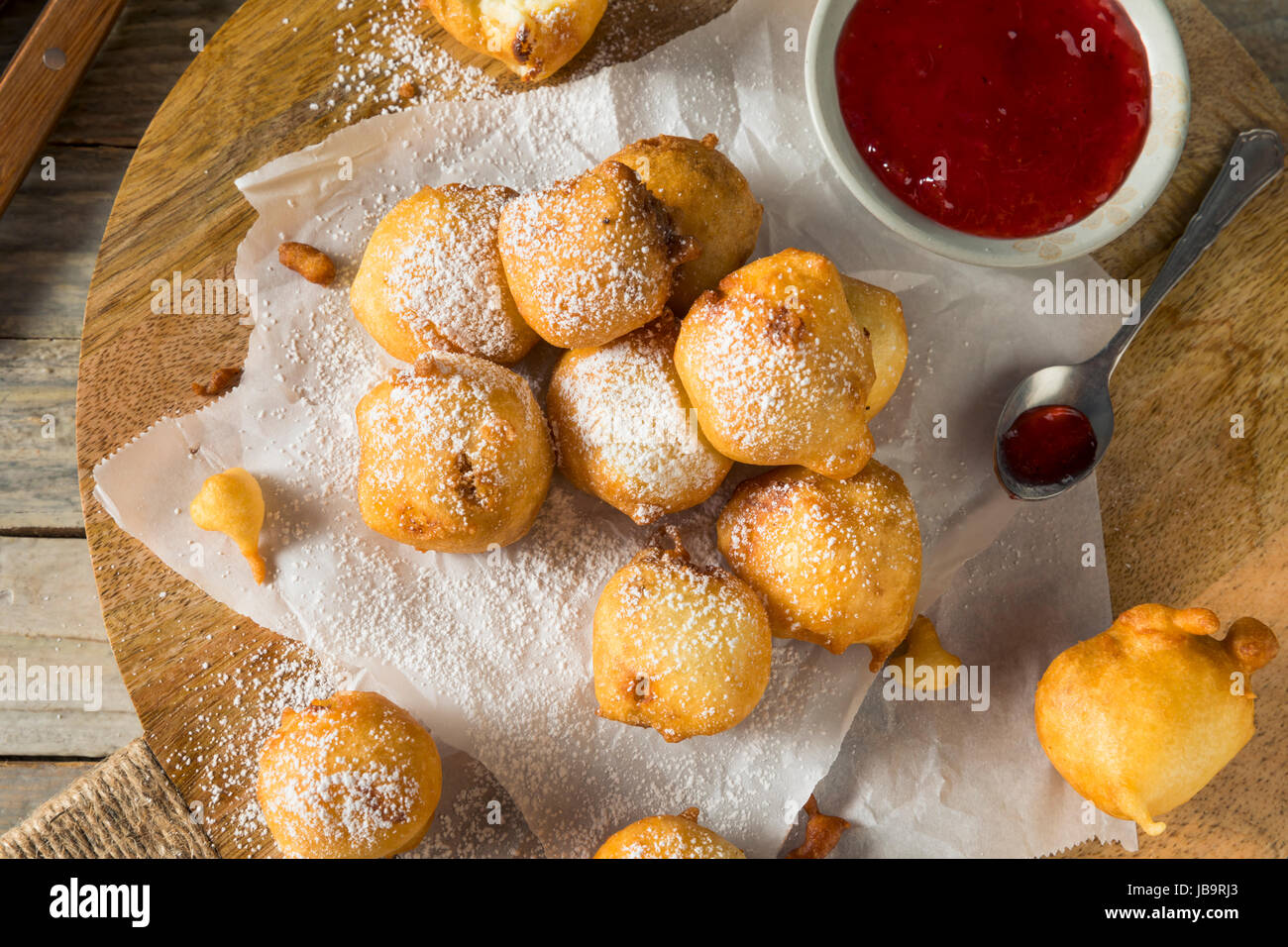 Homemade Deep Fried Cheesecake Bites with Powdered Sugar - Stock Image