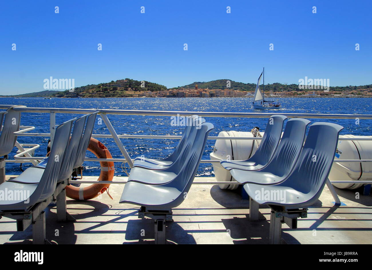 Saint-Tropez, Provence, France - August 21 2016: Seats on a passenger ferry from St Raphael to St Tropez, with a - Stock Image