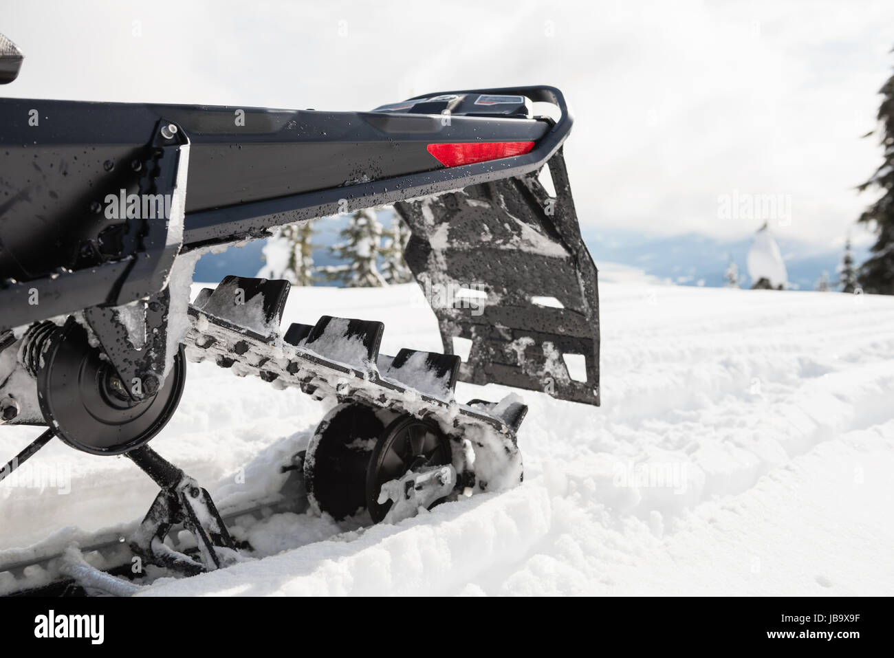 Snowmobile in snowy alps during winter - Stock Image