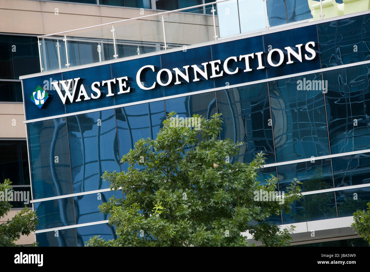 A logo sign outside of a facility occupied by Waste Connections, Inc., in The Woodlands, Texas, on May 28, 2017. - Stock Image