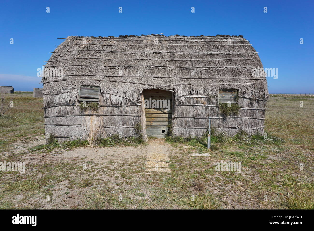 Traditional fishermen hut made from reed, Canet en Roussillon, Pyrenees Orientales, Roussillon, south of France - Stock Image