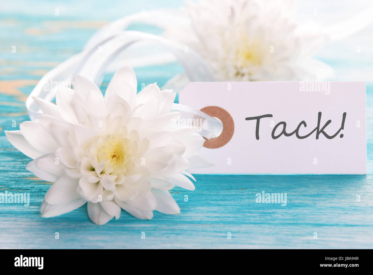 Label with the swedish word tack which means thanks and white label with the swedish word tack which means thanks and white flowers mightylinksfo