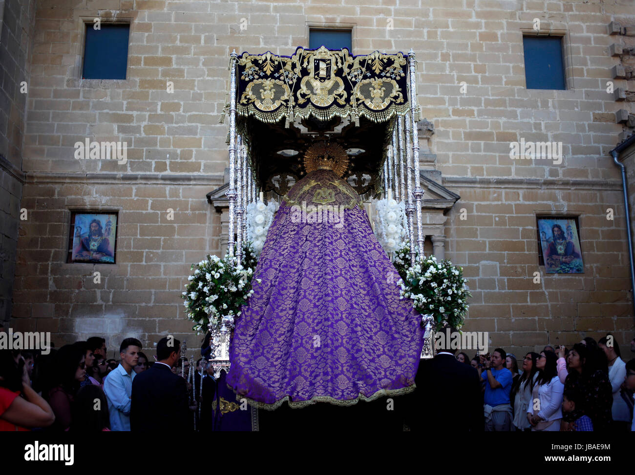 An image of the Virgin Mary covered with a big purple cloak and under a pallium is displayed during Easter Week - Stock Image