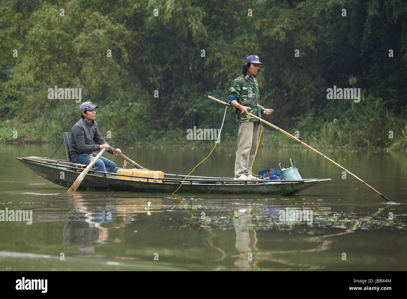 Fishermen on Ngo Dong River, (UNESCO World Herritage Area), near Ninh Binh, Vietnam - Stock Image