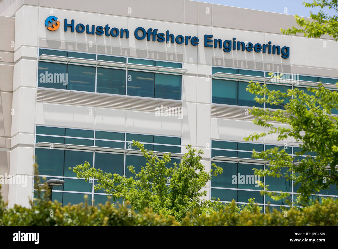 A logo sign outside of the headquarters of Houston Offshore Engineering in Houston, Texas, on May 27, 2017. - Stock Image