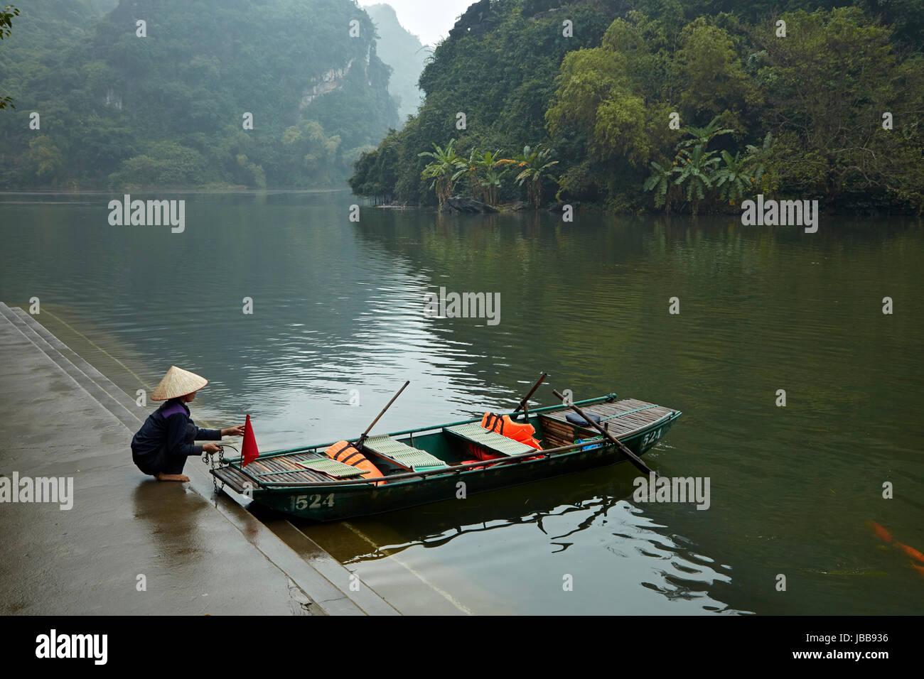 Tourist boat for Trang An Grottoes trip (UNESCO World Heritage Area), near Ninh Binh, Vietnam - Stock Image