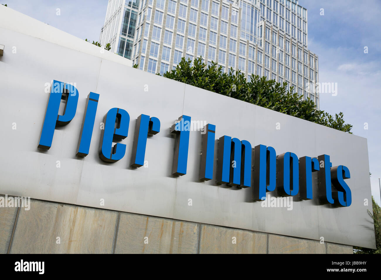 A logo sign outside of the headquarters of Pier 1 Imports Inc., in Fort Worth, Texas, on May 29, 2017. - Stock Image
