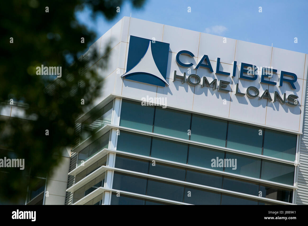 A Logo Sign Outside Of The Headquarters Of Caliber Home Loans Inc