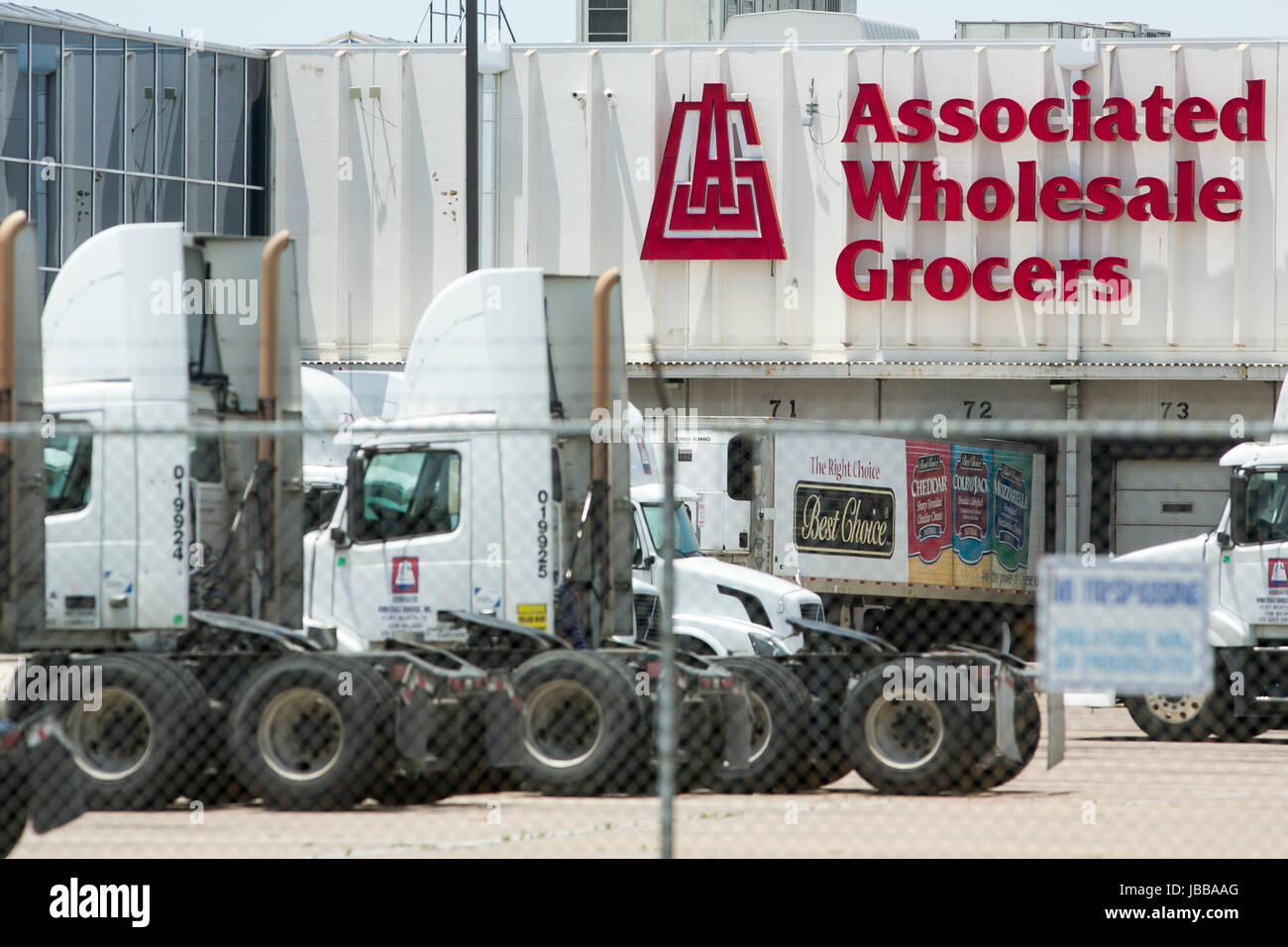 A logo sign outside of a facility occupied by Associated Wholesale Grocers, Inc., in Fort Worth, Texas, on May 29, Stock Photo