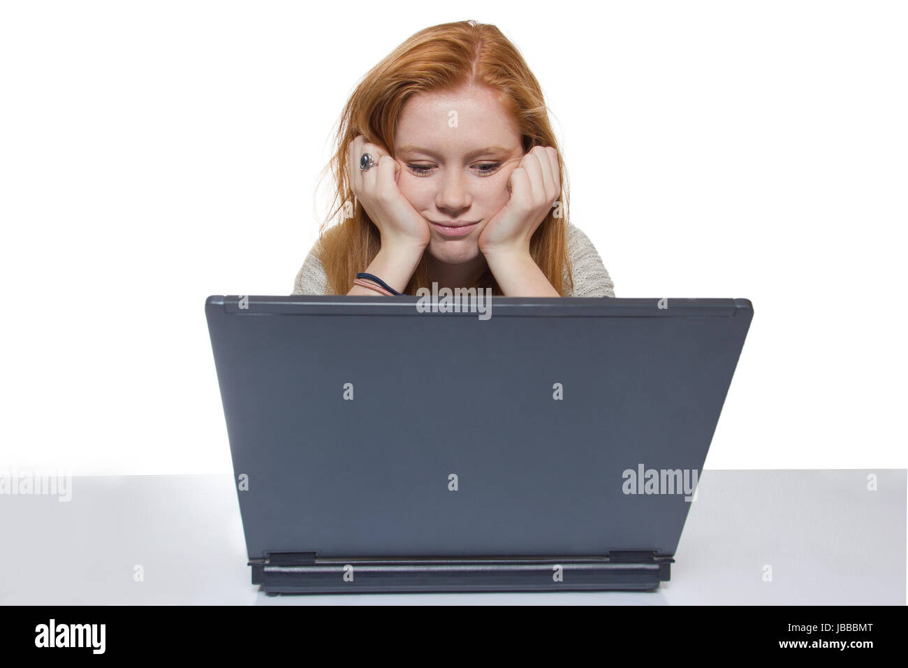 female student sitting bored and frustrated in front of the computer