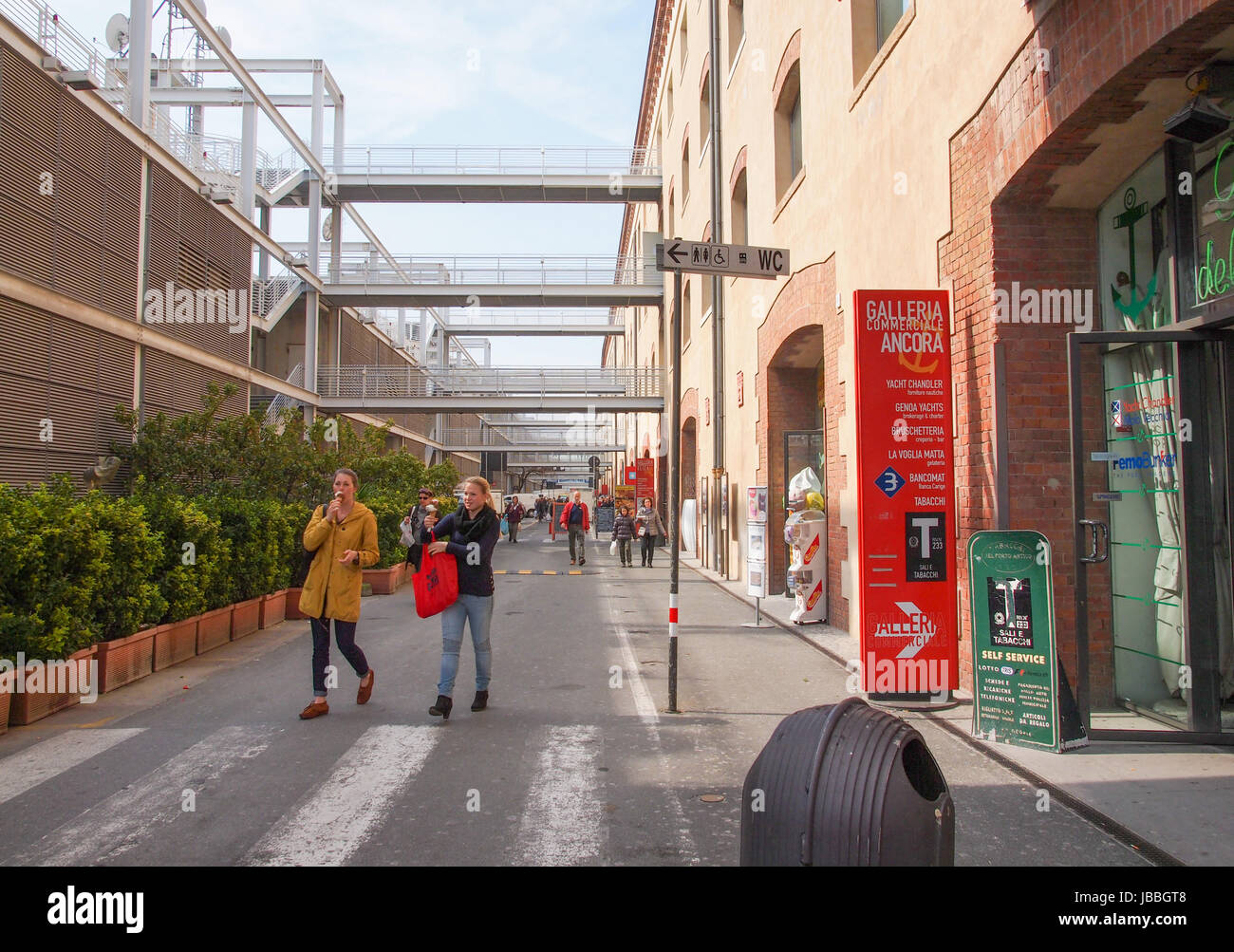 GENOA, ITALY - MARCH 16, 2014: Tourists visiting the Porto Antico old harbour docks redesigned by architect Renzo Stock Photo